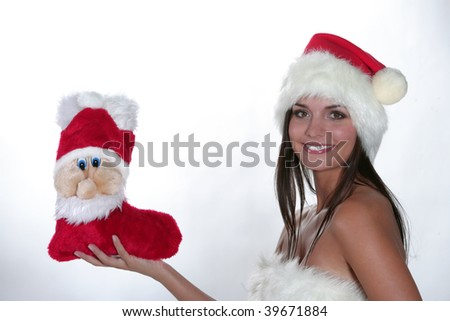 Christmas woman in a Santa Cap. Isolated over white background - stock photo