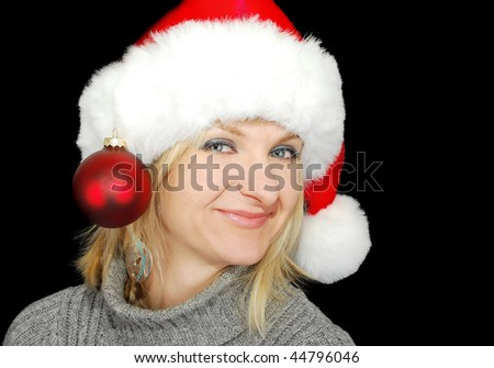 Christmas woman in red hat with ball decoration on the black background