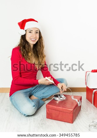 Christmas woman packing gifts