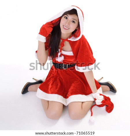 Christmas woman sit on studio white ground with smiling face. - stock photo