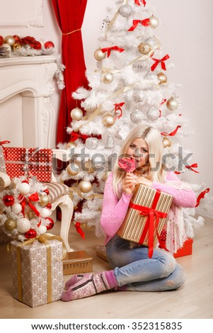 christmas woman, x-mas girl with gift boxes at home new year tree, winter, happiness concept - smiling woman in sweater hold many gift boxes,Christmas eve, instagram filter like, soft grain