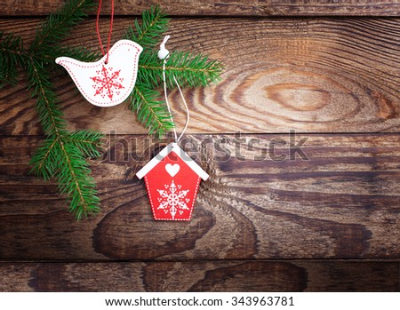 Christmas wooden background with birds fir tree and decor with copy space
