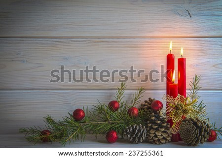 Christmas wooden background with candles and a space for text  - stock photo