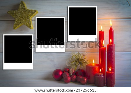 Christmas wooden background with candles and a space for text or photo - stock photo