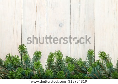 Christmas wooden background with fir tree and copy space - stock photo