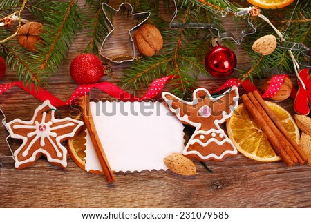 christmas wooden background with homemade gingerbread cookies ,spices,card and decoration