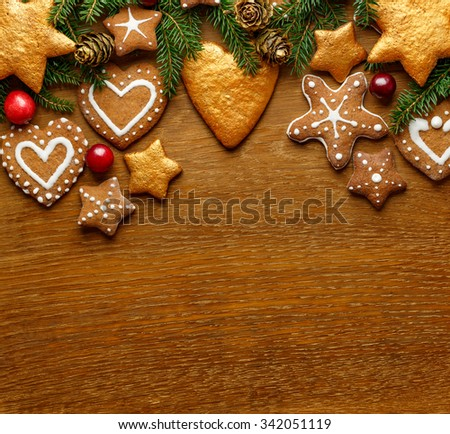 Christmas wooden background with spruce tree and holiday rustic decor