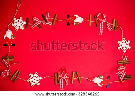 Christmas wooden decorations on a red background - stock photo