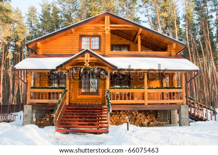 Christmas wooden mansion at pine forest in the morning - stock photo