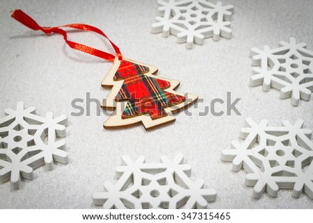 Christmas wooden ornaments toy tree with ribbon .