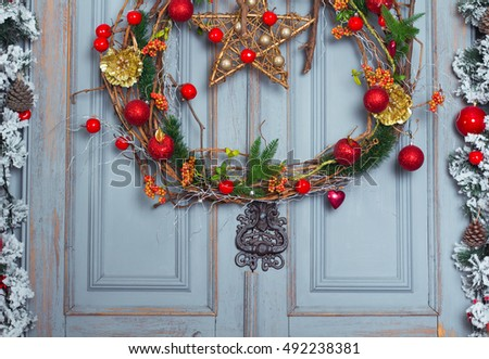 Christmas Wreath decoration at door for holiday. Winter Time, close up