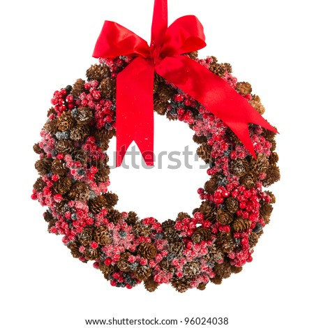 Christmas wreath from pine apples and red berries - stock photo