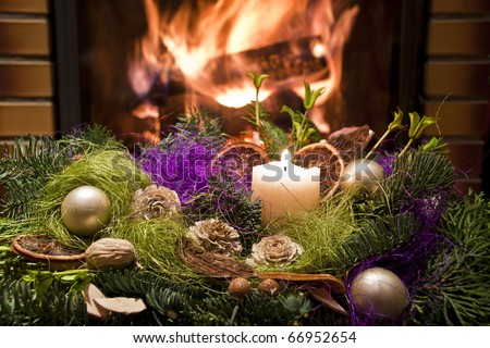 Christmas wreath in front of the fireplace - stock photo
