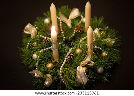 Christmas wreath isolated over dark background - stock photo