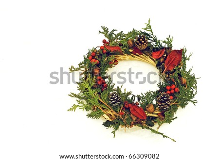 Christmas wreath laying in the snow with copy space. - stock photo