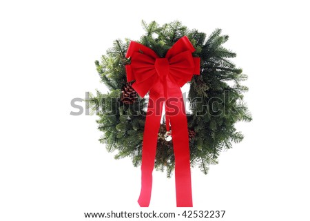 christmas wreath made from fur tree branches and a red bow, isolated on white - stock photo