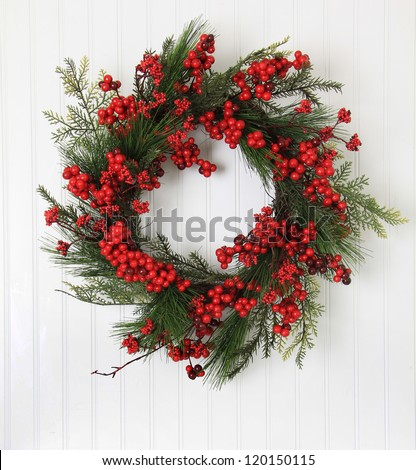 Christmas wreath of berries and evergreen. - stock photo