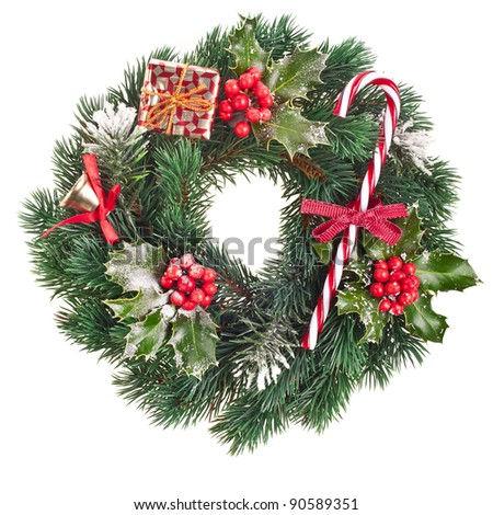 Christmas wreath of nature leaves and berries holly ilex isolated on white - stock photo