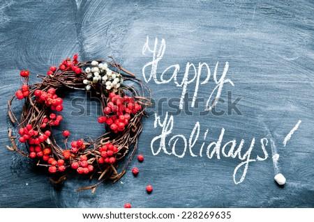 Christmas wreath on a blackboard - stock photo