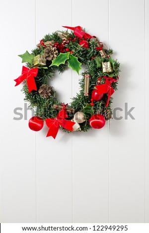 Christmas wreath on a front door - stock photo