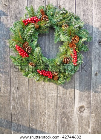 Christmas wreath on a rustic wooden background