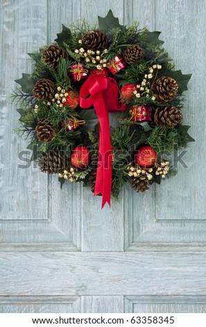 Christmas wreath on door - stock photo