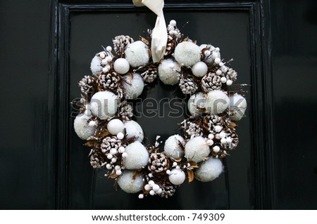 christmas wreath on door - stock photo