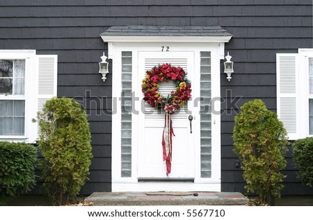 Christmas wreath on front door - stock photo