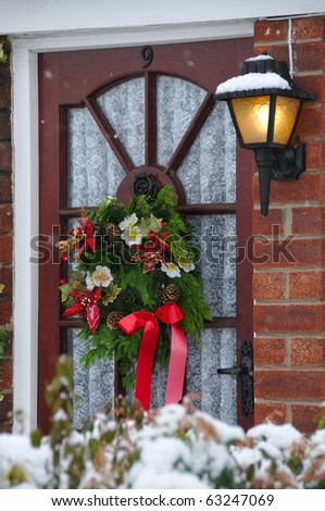 Christmas Wreath on Front Door in the Snow - stock photo