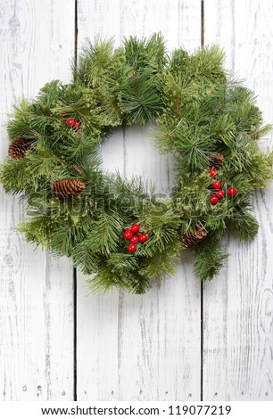 Christmas wreath on old white wooden  door - stock photo