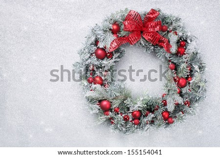 Christmas wreath on silver glitter background - stock photo
