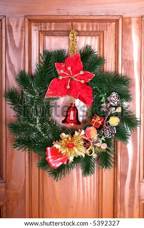 Christmas wreath on the door - stock photo