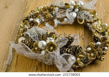 Christmas wreath on the table - stock photo