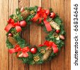 Christmas wreath on the wood door - stock photo