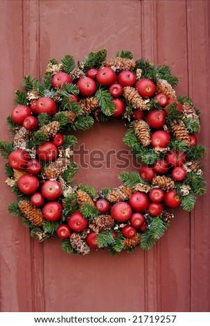 Christmas wreath on wooden door - stock photo