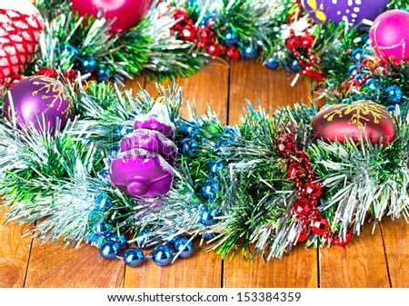 Christmas wreath, ornament  on a wooden background - stock photo