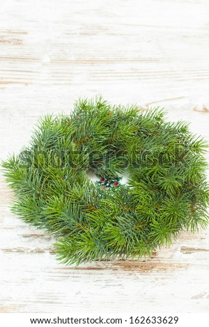 Christmas wreath over old wooden  background. Copy space composition - stock photo