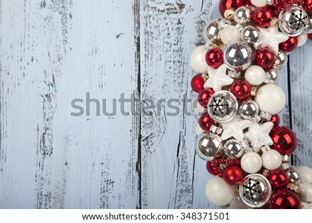Christmas wreath with bells on light blue wooden background