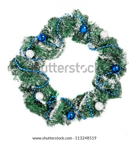 Christmas wreath with blue and silver decorations on white background - stock photo