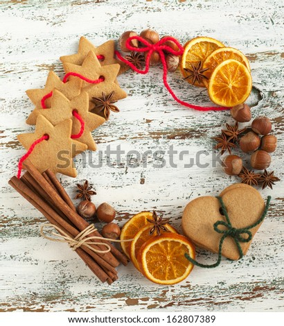 Christmas wreath with cookies and spices - stock photo