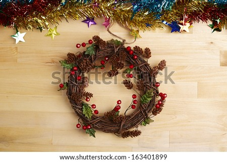 Christmas wreath with decoration on the wood background