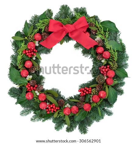 Christmas wreath with red bauble decorations and bow, holly, ivy, mistletoe and winter greenery over white background. - stock photo