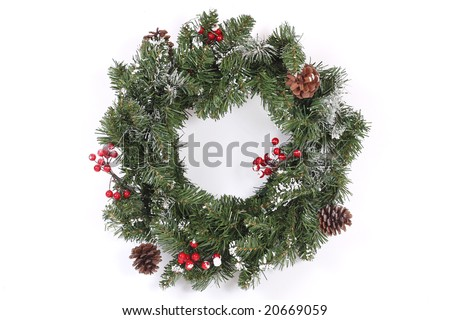 Christmas wreath with red berries and cones - stock photo