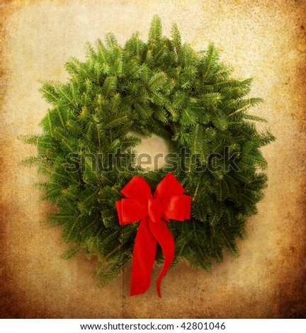 Christmas wreath with red bow - stock photo