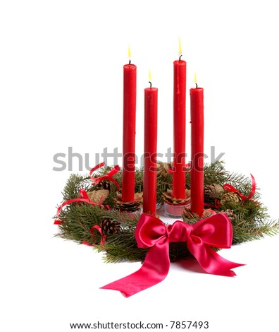 Christmas wreath with red candles and pine cones isolated on white - stock photo