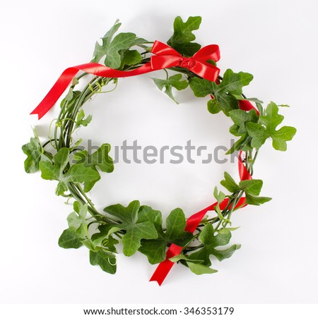 christmas wreath with red ribbon bow isolated on white background - stock photo