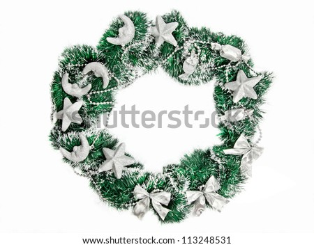 Christmas wreath with silver decorations on white background - stock photo
