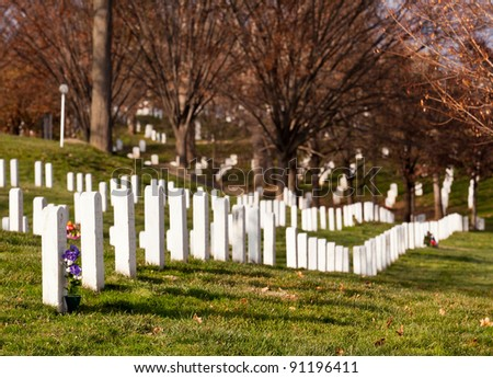 Christmas wreaths on gravestones in Arlington National Cemetery. The wreathes have been donated each year since 1992. - stock photo