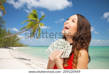 christmas, x-mas, sale, banking and travel concept - smiling woman in red dress with us dollar money over tropical beach background - stock photo