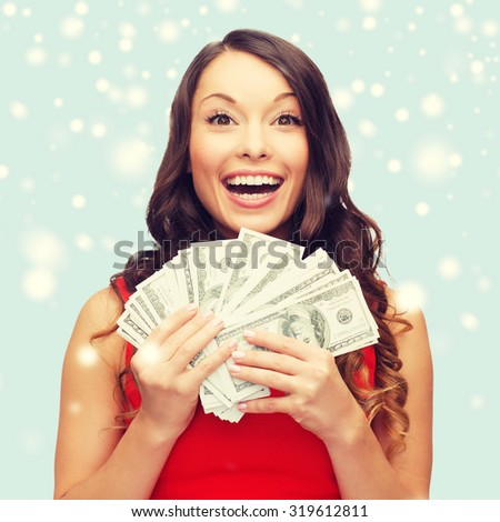 christmas, x-mas, sale, banking concept - smiling woman in red dress with us dollar money - stock photo